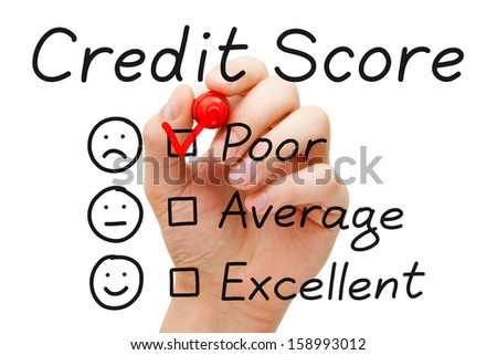 Hand putting check mark with red marker on poor credit score evaluation form. - stock photo