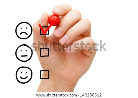 Hand putting check mark with red marker on poor customer service evaluation form. - stock photo