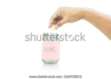hand putting coin in a coin jar, saving money for home isolated on white  - stock photo
