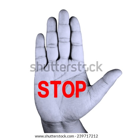 Hand raised with stop painted - stock photo