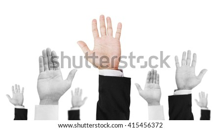 Hand raising upward, with unique colored one, isolated on white background - stock photo