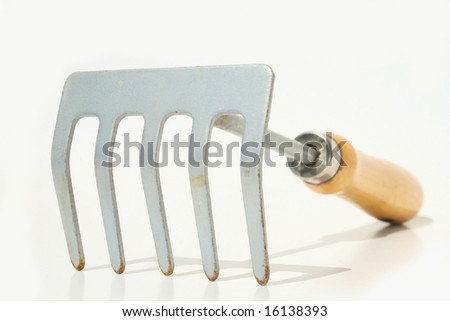 Hand rake against white background - stock photo
