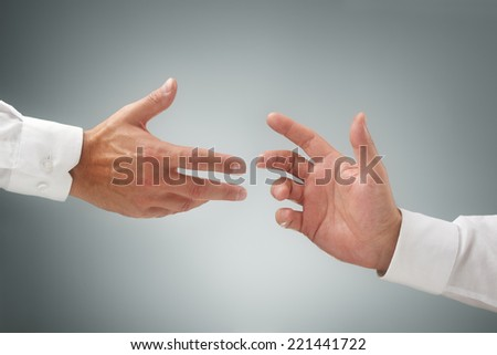 Hand reaching for assistance, support or friendship - stock photo