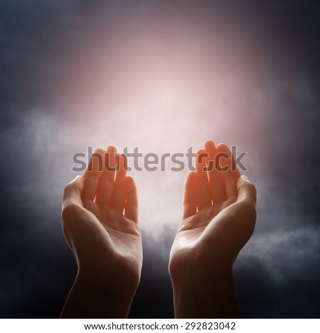 Hand reaching for the cloud in the sky - stock photo