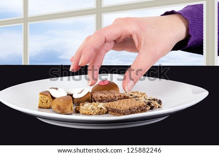 Hand reaching through the window to the cake plate