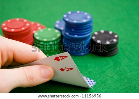 Hand revealing aces