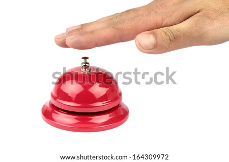 Hand ringing in red service bell  - stock photo