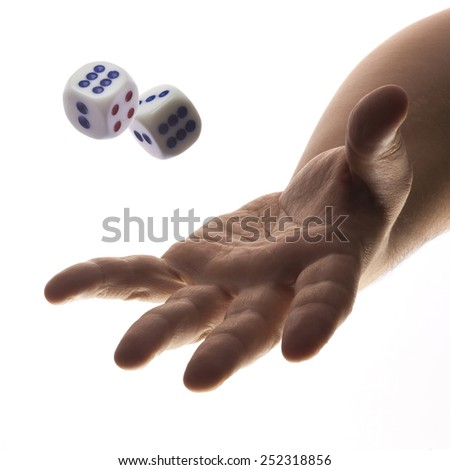 Hand rolling dices isolated on white background. - stock photo
