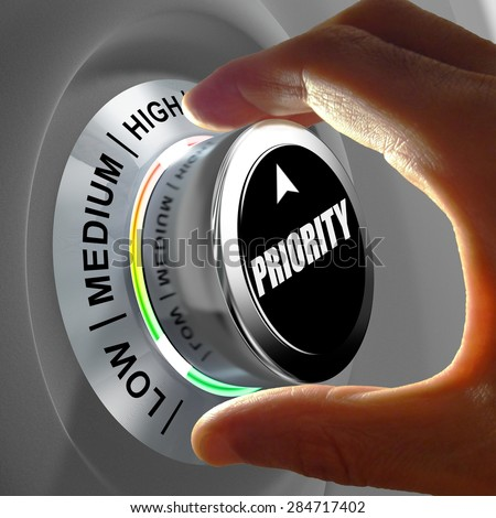 Hand rotating a button and selecting the level of priority. This concept illustration is a metaphor for choosing the level of priority (task). Three levels are available: low, medium and high. - stock photo