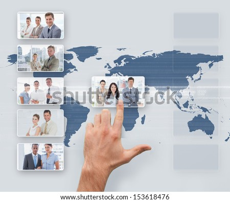 Hand selecting digital interface showing business people