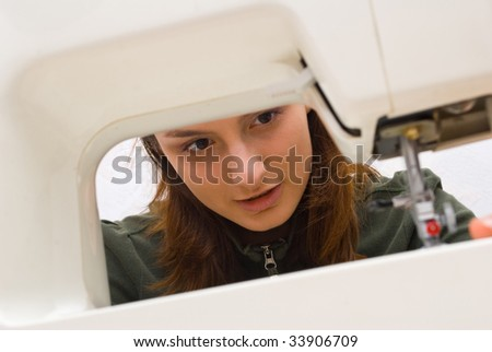 Hand sewing on a machine - stock photo