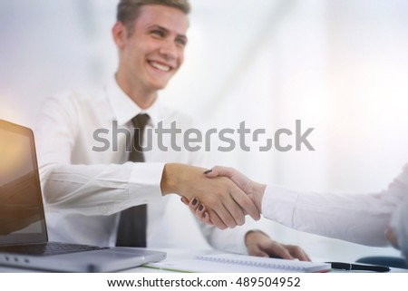 Hand shake at the end of the meeting