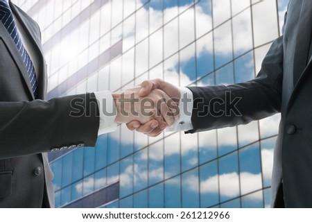 Hand shake of businessman - stock photo