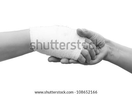 hand shake with hand bandage,black and white - stock photo