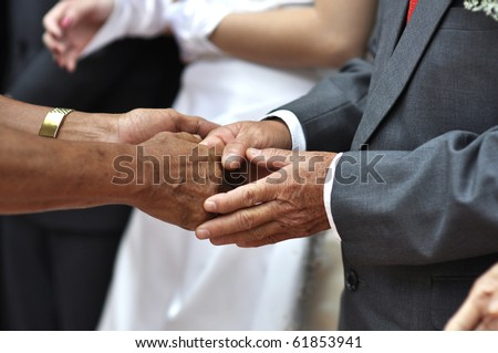Hand shaking and welcoming guest during wedding day. - stock photo