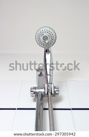 hand shower head  with residual limestone closeup - stock photo