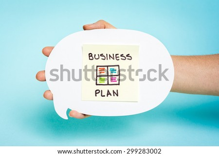 """Hand showing a note with note """"Business plan"""", swot matrix, management, project, speech bubble, blue background. - stock photo"""