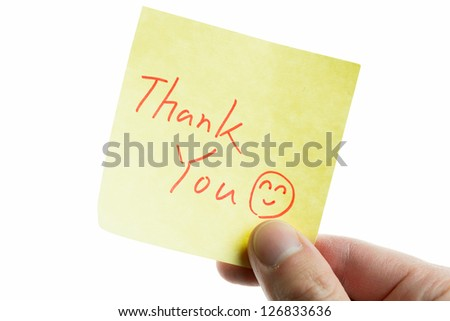 hand showing a post-it to thank you - stock photo