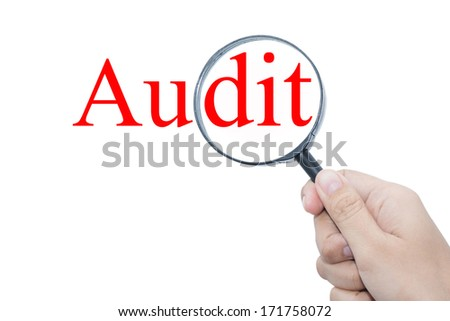 Hand Showing Audit Word Through Magnifying Glass  - stock photo