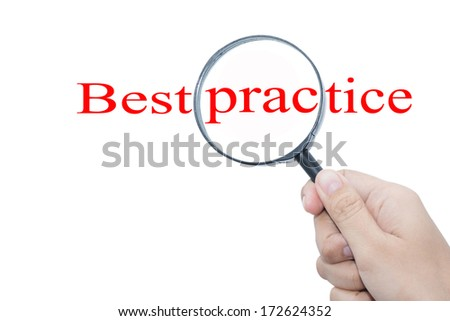 Hand Showing Best practice Word Through Magnifying Glass  - stock photo