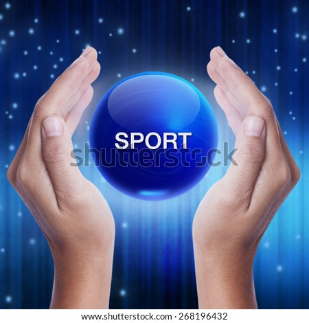 Hand showing blue crystal ball with sport word. business concept - stock photo