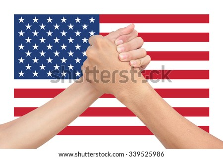Hand showing Cooperation to solve the problem and encouraging. The United States flag in the background.