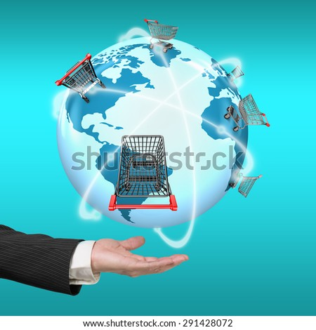 Hand showing 3D globe with world map of shopping carts worldwide, global shopping concept. - stock photo