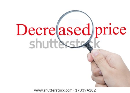 Hand Showing Decreased price Word Through Magnifying Glass  - stock photo