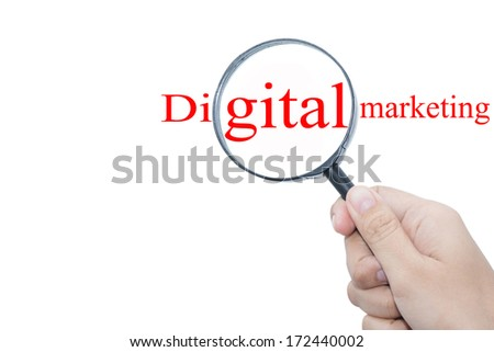 Hand Showing Digital marketing Word Through Magnifying Glass  - stock photo