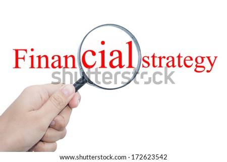 Hand Showing Financial strategy Word Through Magnifying Glass  - stock photo