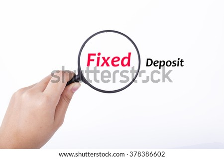 Hand showing FIXED DEPOSIT word through magnifying glass. Isolated white, financial and business concept - stock photo