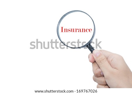 Hand Showing Insurance Word Through Magnifying Glass - stock photo