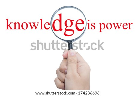 Hand Showing knowledge is power Word Through Magnifying Glass  - stock photo
