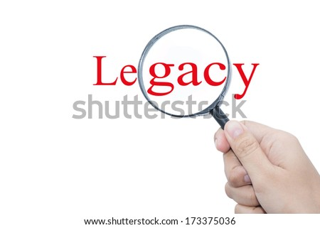 Hand Showing Legacy Word Through Magnifying Glass  - stock photo