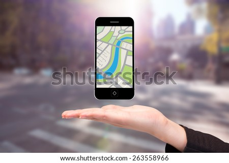 Hand showing map app on phone against blurred new york street - stock photo