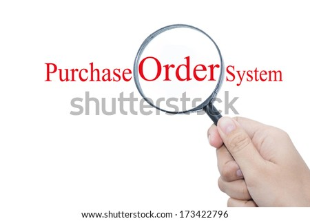 Hand Showing Purchase Order System Word Through Magnifying Glass
