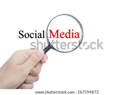 Hand Showing Social Media Word Through Magnifying Glass  - stock photo