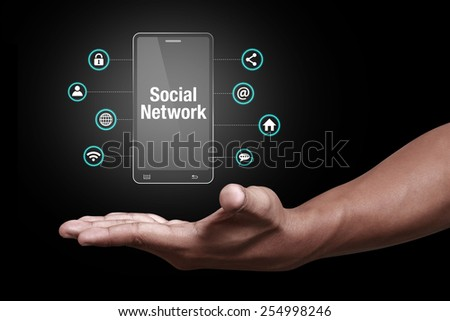Hand showing social network icon - stock photo