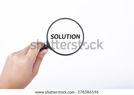 Hand showing SOLUTION word through magnifying glass. Isolated white, financial and business concept - stock photo