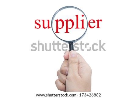 Hand Showing supplier Word Through Magnifying Glass  - stock photo