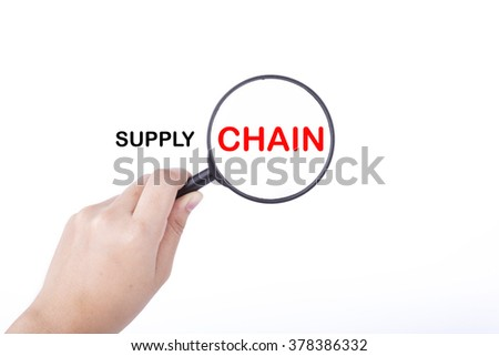 Hand showing SUPPLY CHAIN word through magnifying glass. Isolated white, financial and business concept - stock photo