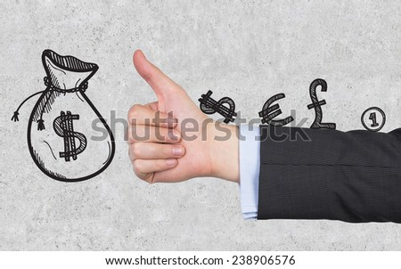 hand showing thumb up on gray background - stock photo