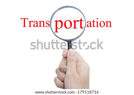 Hand Showing transportation Word Through Magnifying Glass - stock photo