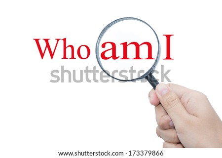 Hand Showing Who am I Word Through Magnifying Glass  - stock photo