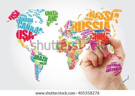 Hand showing World Map in Typography word cloud concept, names of countries - stock photo