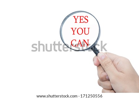 Hand Showing Yes you can Word Through Magnifying Glass