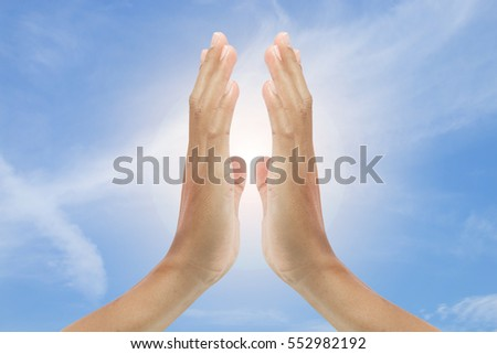 hand sign with blue sky background