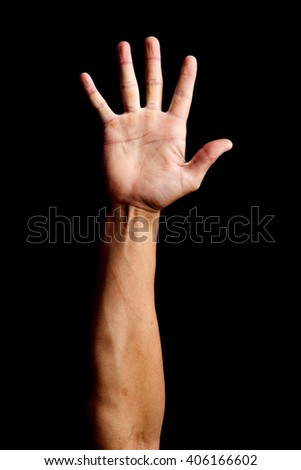 Hand signal in a black backgrownd - stock photo
