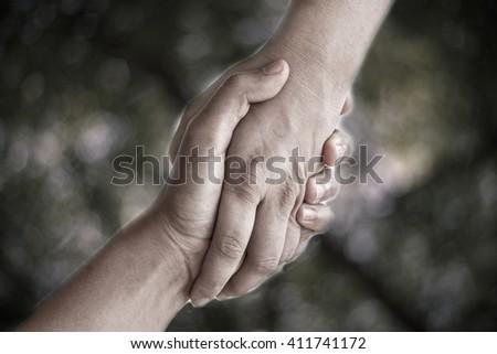 Hand signal  on bokeh background. - stock photo