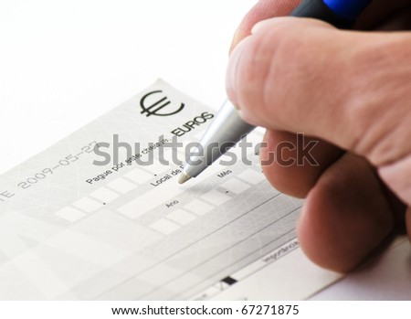 hand signing a check - stock photo